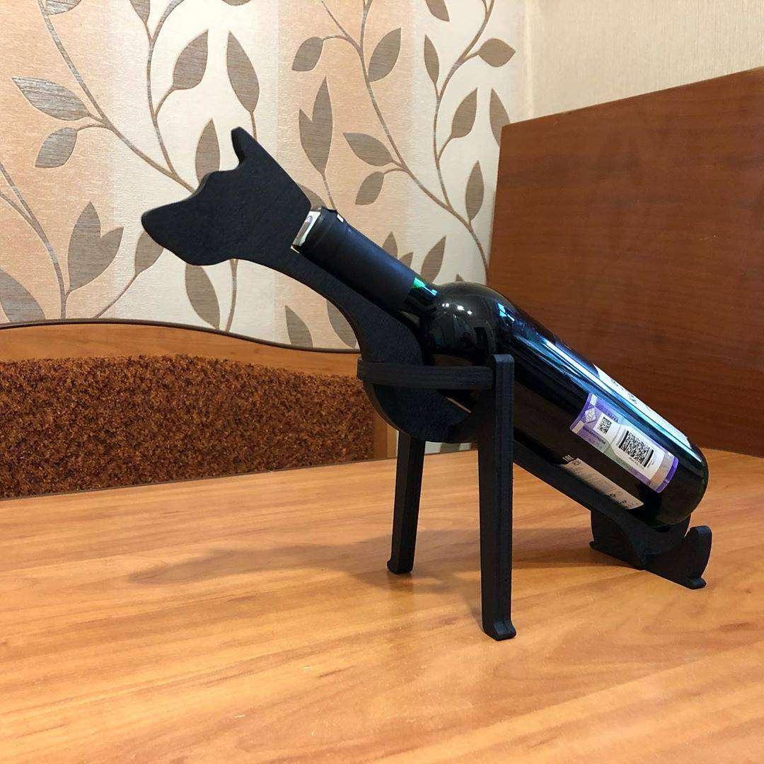 Подставка «Собака» Подставка в форме собаки под бутылку вина. Материал - дерево. Цвет - черный матовый. Подставка под бутылку, Олень, Собака, подставка собака - Цена, Стоимость - 200 руб.(доставка по всей России)